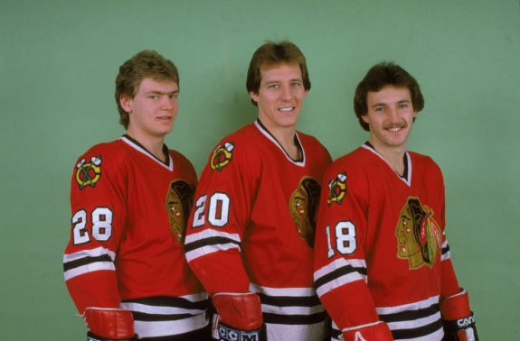 Steve Larmer, Al Secord, and Denis Savard