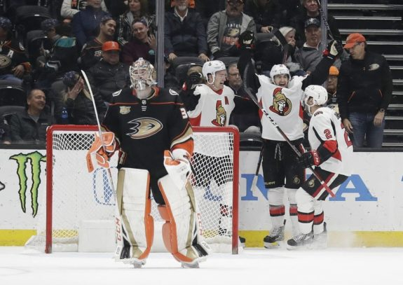 Ottawa Senators' Colin White Dylan DeMelo and Mark Stone Anaheim Ducks John Gibson