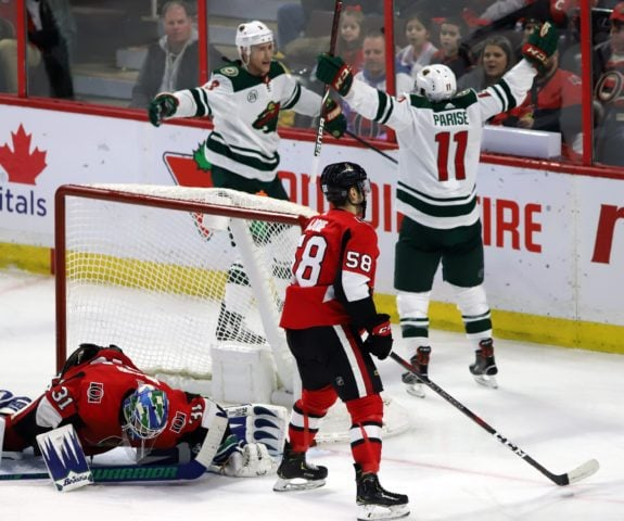 a05ce2dc9cc Minnesota Wild's Zack Parise and Charlie Coyle as Ottawa Senators Anders  Nilsson and Maxime Lajoie