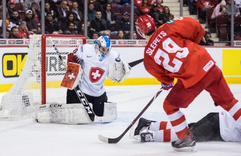 Switzerland goalie Luca Hollenstein Russia's Kirill Slepets