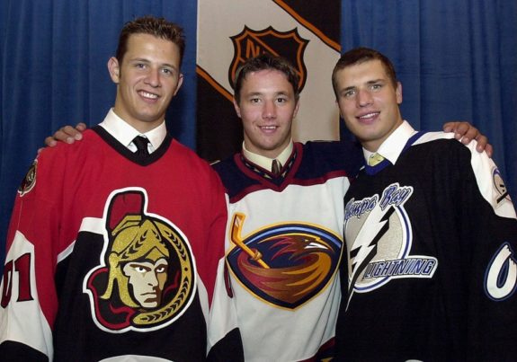 Jason Spezza, left, selected by the Ottawa Senators second overall, Ilya Kovalchuk selected by the Atlanta Thrashers first overall, and Alexander Svitov selected by the Tampa Bay Lightning