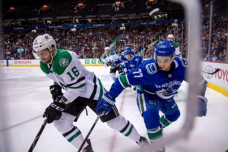 Dallas Stars' Jason Dickinson and Vancouver Canucks' Nikolay Goldobin