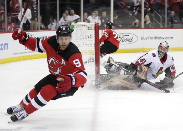 Ottawa Senators goaltender Craig Anderson and New Jersey Devils left wing Taylor Hall