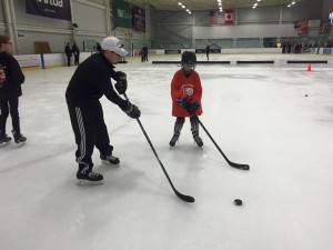 Flyers Youth Special Hockey Club player Tim takes instruction from Coach Zach. Photo courtesy of Mike Kehoe