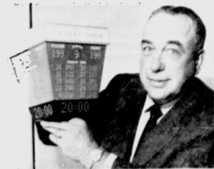 Canadiens' coach Toe Blake with a model of the Forum's new score clock.