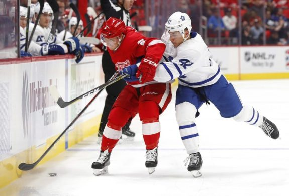 Toronto Maple Leafs left wing Trevor Moore and Detroit Red Wings defenseman Joe Hicketts