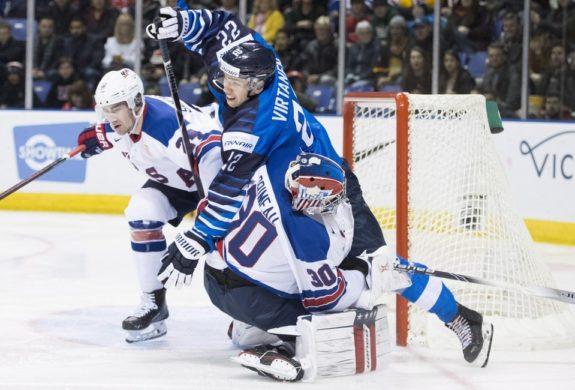 Team USA's Mattias Samuelsson Finland Santeri Virtanen United States Cayden Primeau