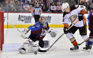 Apr 9, 2016; Denver, CO, USA; Anaheim Ducks left wing Jakob Silfverberg (33) attempts to score past Colorado Avalanche goalie Semyon Varlamov (1) in the third period at Pepsi Center. The Ducks defeated the Avalanche 5-3. Mandatory Credit: Ron Chenoy-USA TODAY Sports
