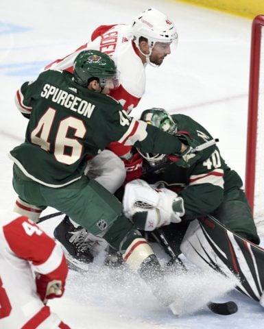 Detroit Red Wings' Luke Glendening Minnesota Wild Jared Spurgeon Devan Dubnyk