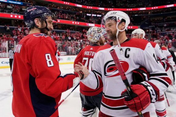 Alex Ovechkin #8 of the Washington Capitals and Justin Williams of the Carolina Hurricanes