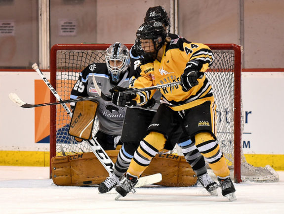 Zoe Hickel of the Boston Pride attempts to deflect a puck in front of Brianne McLaughlin of the Buffalo Beauts. (Photo Credit: Troy Parla)