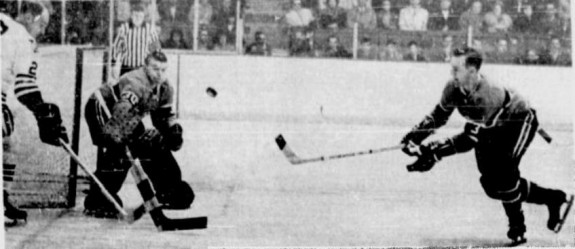 J.C. Tremblay retrieves puck in front of Gump Worsley. Doug Mohns is at left.