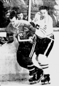 Canadiens Claude Provost is roughed up by Marcel Pronovost.