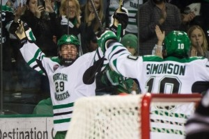 UND forward Johnny Simonson and Bryn Chyzyk Celebrate goal. (Peter Bottini, UND Sports)