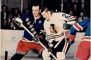 Harry Howell battled with Stan Mikita.