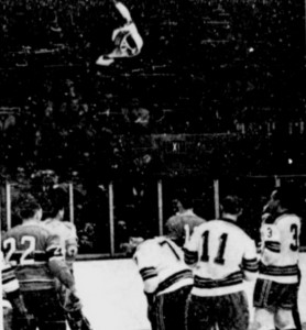 Claude Larose tosses Rangers Arnie Brown's sweater into the crowd.