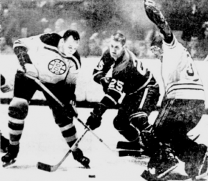 Bruins Al Langlois and Bernie Parent foil a chance by Leafs Orland Kurtenbach.