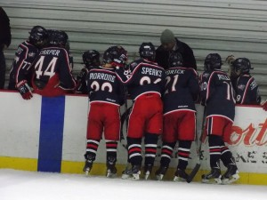 14U AAA Blue Jackets go over plays before a game. Photo Credit : Elaine Shircliff