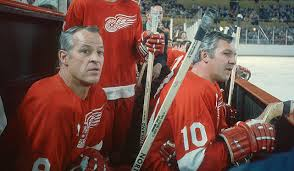 Alex Delvecchio (10) and Gordie Howe
