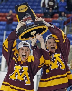 University of Minnesota co-captains Hannah Brandt and Lee Stecklein lift the National Championship trophy in 2016. Photo: Eric Miller/Gopher Athletics