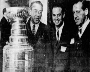 St. Louis Blues executives with the Stanley Cup