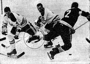 Blades' Gary Kilpatrick trips Jack Evans of the Seals.