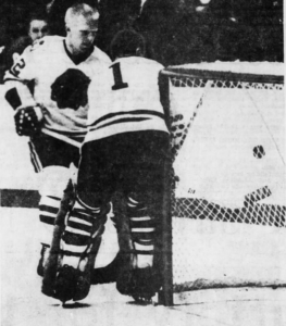 Chicago's Pat Stapleton and goalie Denis DeJordy cover a shot by Detroit's alex Delvecchio.