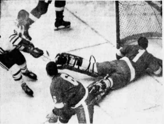 Memphis goalie George Gardner stretches to made a save on St. Louis forward Mike Chernoff (6) as Wings defenceman Doug Barrie watches.