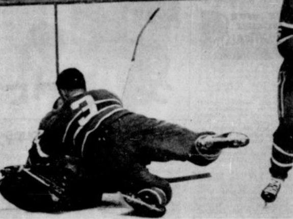 J.C. Tremblay and Gump Worsley do their best to cover a loose puck Saturday night in Montreal.