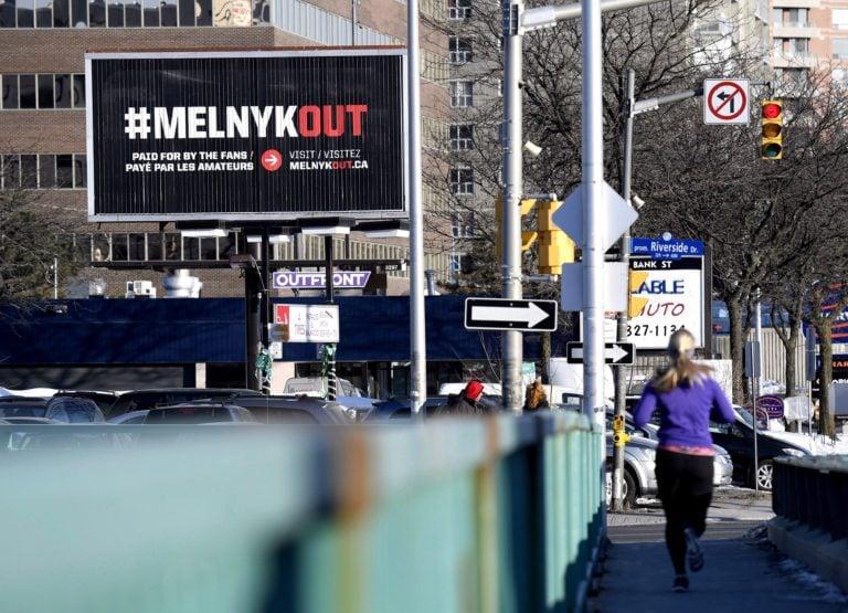 A billboard calling for Ottawa Senators owner Eugene Melnyk