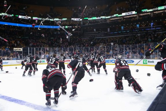 Northeastern celebrating their 2019 Beanpot victory