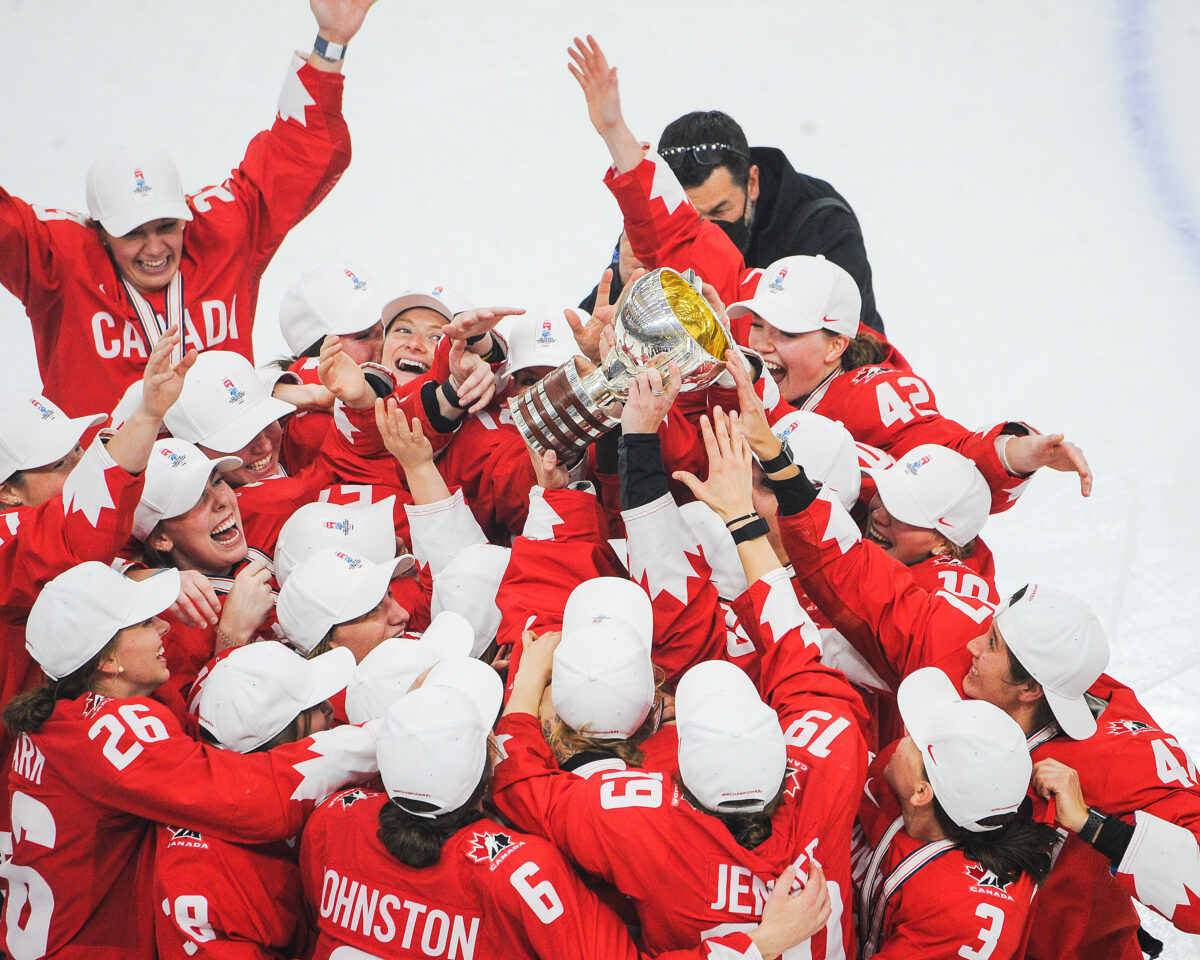 Team Canada celebrates after winning gold at the 2021 IIHF Women's World Championship
