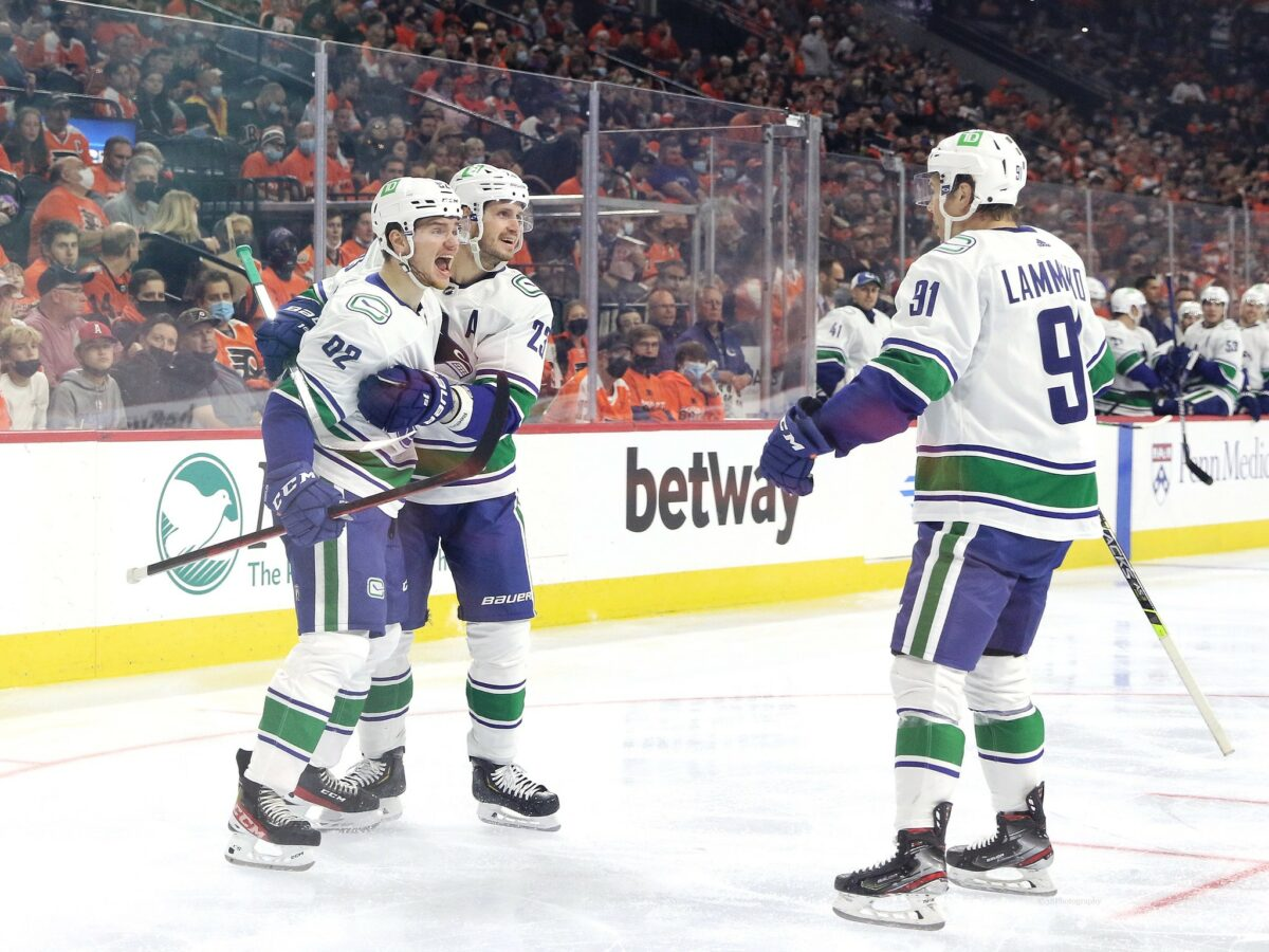 Vancouver Canucks Vasily Podkolzin, Oliver Ekman-Larsson and Juho Lammikko celebrate